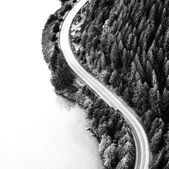 AAA Hero Image: cloudy road in the mountains